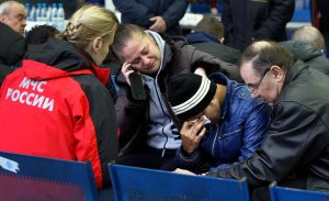 Relatives of the victims of the airplane crash speak with a Russian Emergency psychologist (L)  at the airport in Rostov-on-Don on March 19, 2016. at the airport in Rostov-on-Don on March 19, 2016. All sixty-two people on board a flydubai Boeing 737 were killed when the plane crashed and burst into flames as it was landing in Rostov-on-Don, in Southern Russia, on Saturday morning, officials said. The plane was making its second attempt to land in bad weather when it missed the runway, erupting in a huge fireball as it crashed and leaving debris scattered across a wide area. / AFP / SERGEI VENYAVSKY        (Photo credit should read SERGEI VENYAVSKY/AFP/Getty Images)